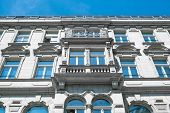 restored facade of old apartment building in Berlin poster