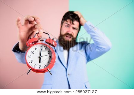 How Much Time Left Till Deadline. Time To Work. Man Bearded Stressful Businessman Hold Clock. Stress
