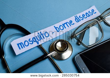 Conceptual Image With Mosquito - Borne Disease Inscription With The View Of Stethoscope, Eyeglasses