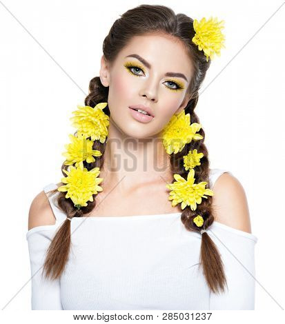 Beautiful stylish woman with long pigtails and  bright yellow make-up. Fashion portrait. Attractive girl with stylish hairstyle, pigtails -   isolated on white. Professional  makeup. Art hairstyle.  poster