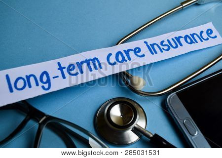 Conceptual Image With Long-term Care Insurance Inscription With The View Of Stethoscope, Eyeglasses