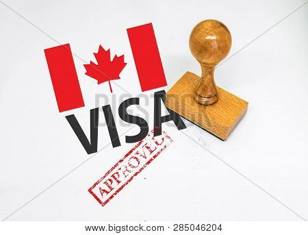 Canada Visa Approved With Rubber Stamp And Flag