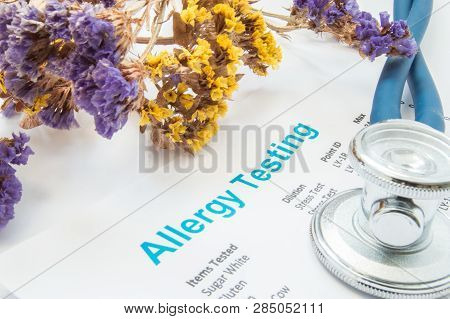 Printed Result Of Allergy Test (blood Or Skin) Lies Next To Flowers With Falling Pollen And Stethosc
