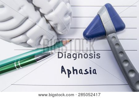 Neurological diagnosis of Aphasia. Neurological reflex hammer, shape of the brain, pen and pencil the lying on a medical report, labeled with diagnosis of Aphasia. Concept for neurology poster