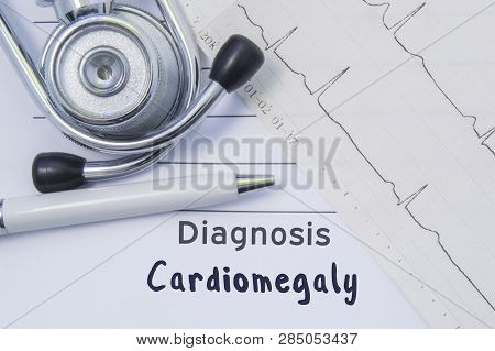 Diagnosis Of Cardiomegaly. Stethoscope, Printed Electrocardiogram And Pen Are On Paper Medical Form
