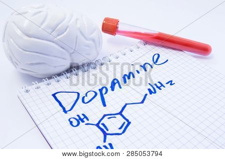 Neurotransmitter Dopamine In Brain. Anatomic 3d Brain Model, Lab Test Tube With Blood And Note, Wher