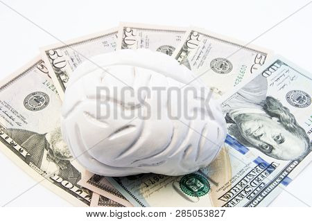 Anatomical Model Of Human Brain Is On The Money - Us Dollar Banknotes. Concept Photo To Visualize Co