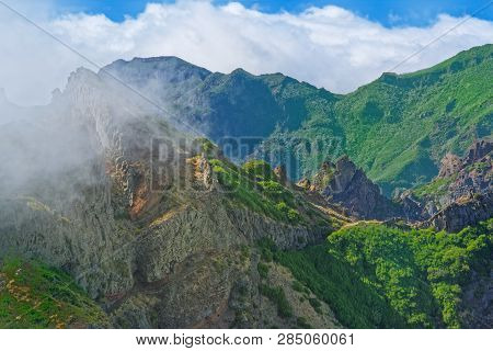Nature Scene Of Green Mountains Against Cloudy Blue Sky. View From Pico Do Ariero On Portuguese Isla