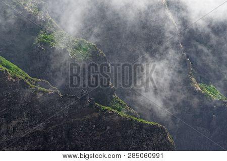 Mountains Ridge In The Fog. Pico Do Arieiro On Portuguese Island Of Madeira