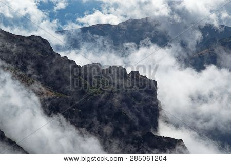 Rocky Formation In The Clouds. View From Pico Do Arieiro On Portuguese Island Of Madeira