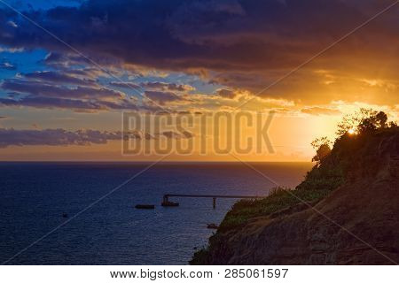 Colorful Sunset On Portuguese Island Of Madeira. View From Funchal City.