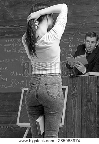 Rear View Girl With Nice Butt Making A Ponytail While Holding A Book Between Her Legs. Teacher Givin