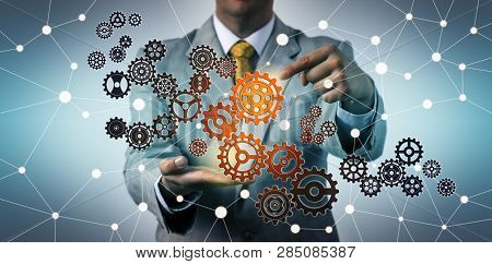 Businessman Touching Virtual Gear In Cyberspace. Technology Concept For Tech Support, Information En