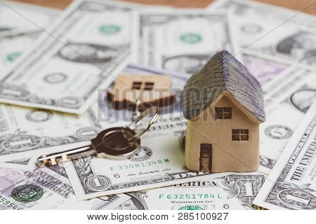 Saving Money For House Or Mortgage, Home Loan Concept, Key With Wooden House Key Chain And Miniature