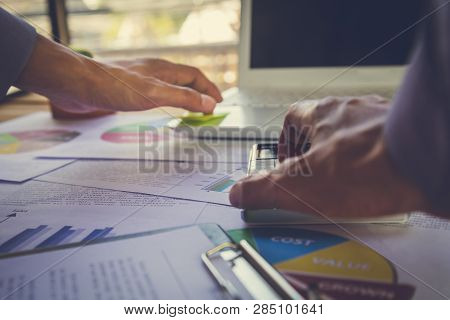 Accountant Working On Calculator To Calculate Accounting And Business Finance Plan Sales. Business A