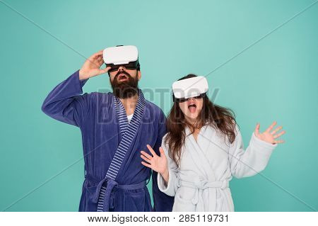 Couple In Bathrobes Wear Vr Glasses. Conscious Awakening. Return To Reality. Man And Woman Explore V