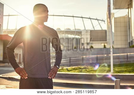 What A Great Day For Workout Athletic African Man With A Muscular Body Standing With Arms On His Hip