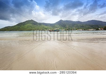 Bright Tropical Landscape, Traditional Thai Fishing Boat On The Background Of The Hills On The Islan