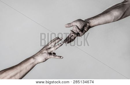 Helping hand outstretched, isolated arm, salvation. Close up help hand. Two hands, helping arm of a friend, teamwork. Helping hand concept and international day of peace, support. Closeup poster