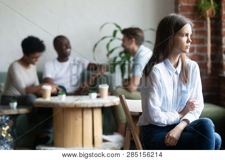 Girl Outcast Sits Apart From Peers In Cafeteria
