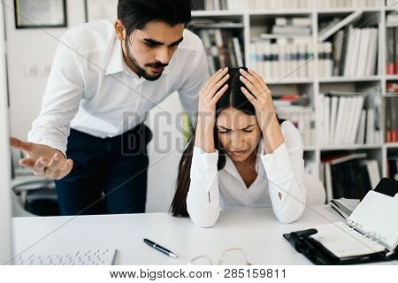 Angry Boss Yelling At His Employee In Office