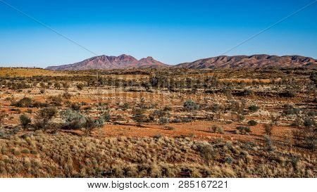 Red Centre Landscape With Distant View Of Mount Sonder In Nt Outback Australia