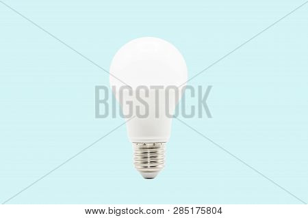 Close Up Led White Light Bulb Isolated On Blue Background. Clipping Path -image.