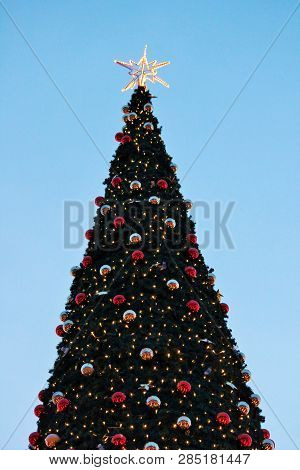 Christmas Tree With Star And Baubles Red And Gold Copy Space