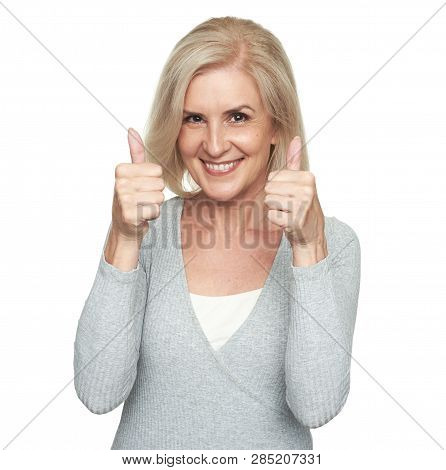 Middle Aged Blonde Woman Showing Thumbs Up