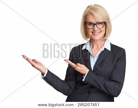 Middle Aged Woman Pointing Hands At Copy Space.