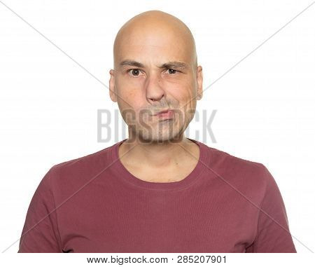 Man Looking At Camera With Suspicious