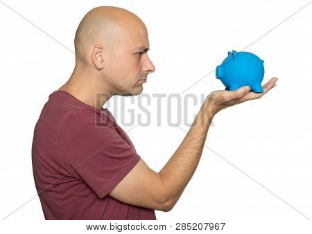 Angry Man Looking At Piggy Bank