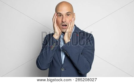 Shocked Bald Man Looking At Camera. Isolated