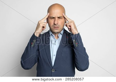 Thoughtful Middle Aged Bald Businessman Thinking