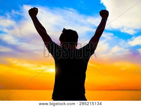 Happy Person Silhouette At The Sunset On The Sea Background