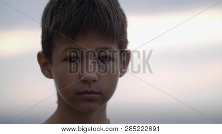 portrait orphan emaciated refugee boy stands alone looking into the camera poster