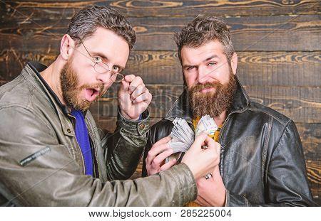 Mafia Business. Impressive Profit. Men Brutal Bearded Hipster Wear Leather Jacket And Hold Cash Mone