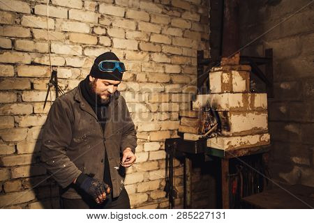 Bearded Blacksmith Fires Fire With Firesteel And Flint