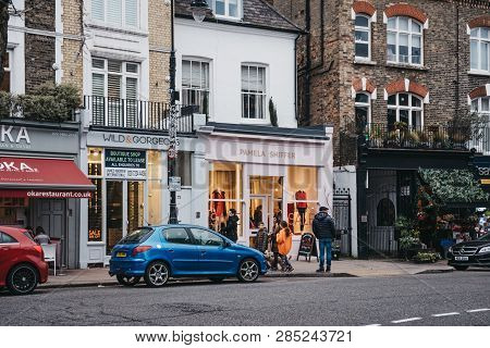 London, Uk - February 16, 2019: People Walking Past The Shops In Primrose Hill, An Upscale Area Of N