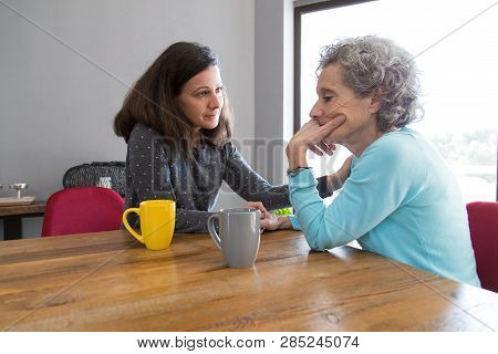 Serious Young Woman Consoling Her Upset Senior Mother. Frustrated Elderly Lady Getting Bad News. Con
