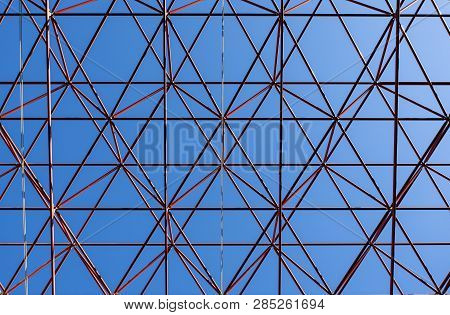Image Shows An Abstract Celling Metal Construction On Blue Sky Background