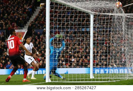 MANCHESTER, ENGLAND - FEBRUARY 12 2019: Presnel Kimpembe of PSG scores a goal during the Champions League match between Manchester United and Paris Saint-Germain at Old Trafford Stadium.