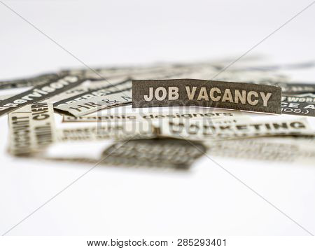 Jobs Or Careers Concept: Job Titles Or Occupations Cut Off From Newspaper And Focus On Job Vacancy