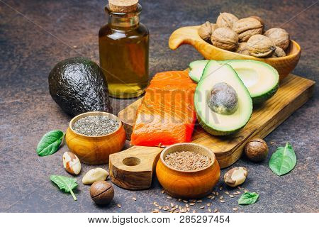 Animal And Vegetable Sources Of Omega-3 Acids As Salmon, Avocado, Linseed, Oil, Nuts, Chia Seeds, Sp