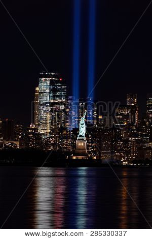 Light Beams With Statue Of Liberty And Lower Manhattan