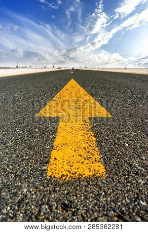 Straight Road With Yellow Road Markings - Arrow