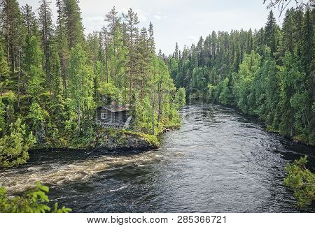 Scandinavian Landscape With An Old Fishermans Hut Along The Oulankajoki River At The Oulanka Nationa