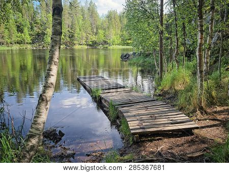 Landscape With A Dock Or A Pier On The Lake On A Sunny Summer Day. Oulanka National Park, Kuusamo, F