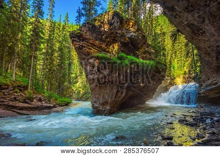 Johnston Creek Photographed From A Cave. Johnston Creek Is A Tributary Of The Bow River In Banff Nat