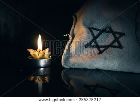 Day Of Memory Of Victims Of The Holocaust Burning In The Night Candle And A Symbol Of The Jewish Sta